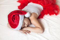 Children's feet in the New Year's striped pajama bottoms to bed, Stock Image