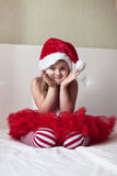 Children's feet in the New Year's striped pajama bottoms to bed, Stock Photos