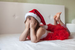 Children's feet in the New Year's striped pajama bottoms to bed, Royalty Free Stock Images