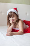 Children's feet in the New Year's striped pajama bottoms to bed, Royalty Free Stock Photo