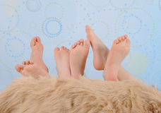 Children's feet over furry blanket Royalty Free Stock Images