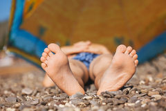 Children's feet on pebbles Royalty Free Stock Photography