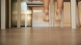 Children's feet running. Across the floor