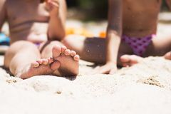 Children's feet in sand on the beach Stock Photo