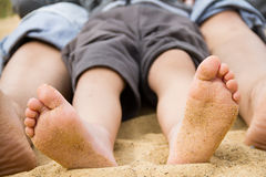 Children's feet in the sand Royalty Free Stock Photography