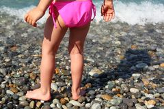Children's feet on seacoast Royalty Free Stock Image