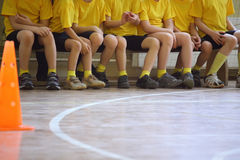 Children's feet in sports hall Stock Photo