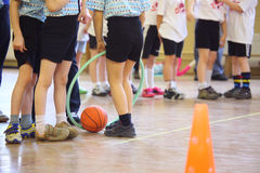 Children's feet in sports hall Stock Photos