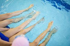 Children`s feet in the water royalty free stock photography