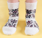 Children's feet in wool socks Stock Photo