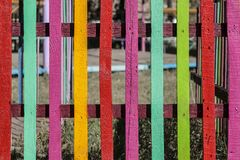 Colored and bright children`s fences. Children`s fence of bright colored dostochk, paired together in the whole on the playground Stock Photography