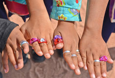 Children's fingers with rings. Beautiful rings in children's fingers Royalty Free Stock Photography