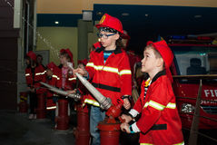 Children`s fire brigade stock images