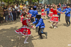 Children's folklore ensemble.#2. Children dance in a city park in the Cossack costumes stock photos