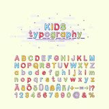 Children`s font in the mbe style. Colorful kids typography. Vector illustration of an alphabet. English, German and Royalty Free Stock Photo