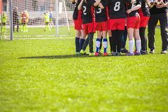 Children`s Football Team on the Pitch. Girls in Black and Red Soccer Uniforms. Children`s Football Team on the Pitch. Girls in Black and Red Soccer Kits Standing Stock Photos