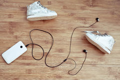 Children's footwear and the smartphone Royalty Free Stock Photography