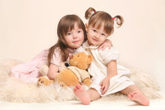 Children's Friendship. Two beautiful girls with teddy bear Royalty Free Stock Image