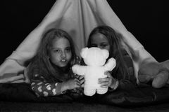 Children`s friendship. PJs party for children as funtime concept. Children`s friendship. PJs party for children. Children and fun time concept. Friends having Royalty Free Stock Images
