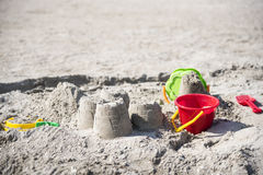 Children`s fun on the beach, toys and built castles, summer rest royalty free stock photo