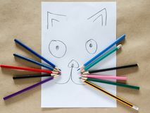 Children`s funny drawing of cat. Cheerful children`s drawing of a cat with a pencil royalty free stock photos