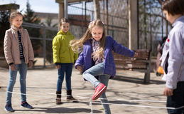 Children`s games. blonde Girl jumps over the rope Royalty Free Stock Photography