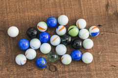 Children`s games, playing marbles, various colored marble paintings, Royalty Free Stock Image