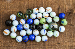 Children`s games, playing marbles, various colored marble paintings, Stock Photography