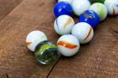 Children`s games, playing marbles, various colored marble paintings, Royalty Free Stock Photo