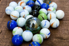 Children`s games, playing marbles, various colored marble paintings, Royalty Free Stock Photos
