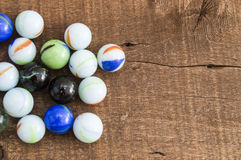 Children`s games playing marbles various colored marble paintings, Stock Images