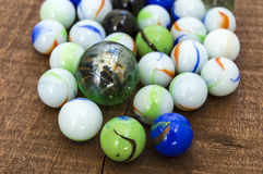 Children`s games playing marbles various colored marble paintings, Royalty Free Stock Photo