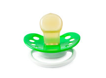 Children's green pacifier. Isolated on white background Stock Photo