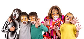 Kids and granny with face-paint royalty free stock images