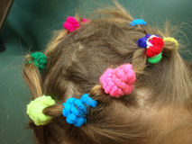 Children`s hair. Collected hair on the baby`s head in the form of a wreath royalty free stock images