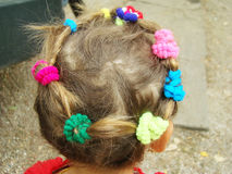 Children`s hair. Collected hair on the baby`s head in the form of a wreath royalty free stock photos