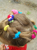 Children`s hair. Collected hair on the baby`s head in the form of a wreath stock photos