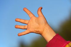 Children's hand against sky Royalty Free Stock Photography
