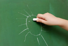 Children's hand with a chalk Royalty Free Stock Photos