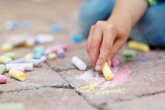 Children's Hand with Colorful chalks Royalty Free Stock Images