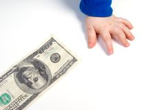 Children's hand and the dollar Stock Photography