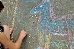 Children`s hand draws with chalk on the pavement Royalty Free Stock Image