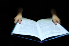 Children`s hand holding a book Stock Photography