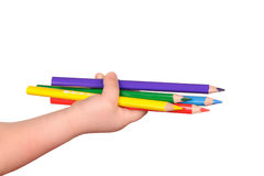 Children's hand holds the colorful pencils Royalty Free Stock Photography