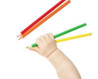 Children's hand holds colour pencils Royalty Free Stock Photography