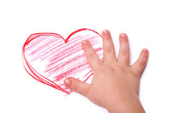 The children's hand is located in heart drawing. Isolated royalty free stock image