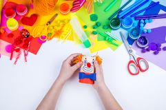 Children`s hand making paper crafts stock images