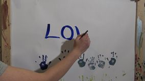 Children's hand in the paint stock video footage