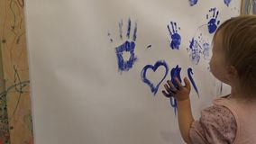 Children's hand in the paint stock video