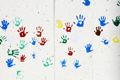 Children's hand prints. Artistic colorful children's hand prints on the wall stock photos